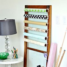 Repurpose an old door or window into a gift wrap center