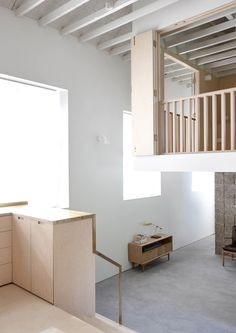 """McLaren Excell creates """"floating"""" loft room inside renovated schoolhouse home"""