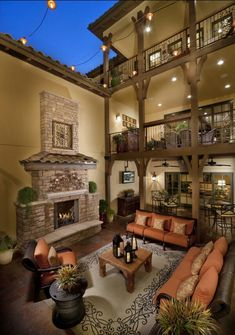 Tuscan style outdoor living space with three patios and a spacious and open plan. Very impressive porch! Maybe incorporate some of these elements on my patio! Outdoor Rooms, Outdoor Living, Indoor Outdoor, Outdoor Seating, Outdoor Patios, Outdoor Kitchens, Outdoor Decor, Style Deco, String Lights Outdoor