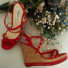 """L.K.Bennett Strappy Sandal. Price Firm Matching trim wrap the base of a cork wedge with soft suede straps. Approx heel 5"""" with a 1"""" platform (equivalent to a 4"""" heel) Leather upper, lining and soles. Inside heel to toe measure approx 10 1/4"""". European size 10 but fit like a 8 1/2-9. Made in Spain. Note- The color is more a coral, my camera shots made it look more red and they are not red. L.K.Bennett Shoes"""