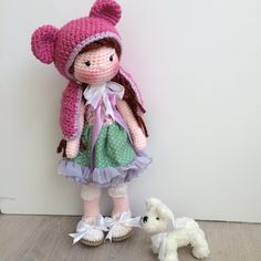 Amigurumi doll and her little crochet doggy