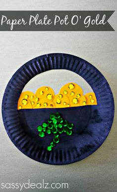 How to make a pot of gold paper plate craft with sequins, paper, and glue. This is a fun st patricks day craft for kids to make. Very cheap and easy DIY.