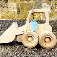 Wood bulldozer toy made from sustainable Maple.
