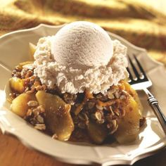 On a chilly fall evening, warm up with this delicious dessert. Crisp and tart apples sweetened with brown sugar and topped with an oat and cheddar cheese crumble. Delicious all by itself or served with ice cream. Cheese Recipes, Cooking Recipes, Delicious Desserts, Dessert Recipes, Fruit Dessert, Fall Desserts, Dessert Ideas, Apple Cobbler, Recipes