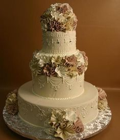 These cakes include decorations that range outside of our basic cake price. This means that these cakes may be decorated with Rolled Chocolate Covering, Rolled Chocolate Flowers, Fresh Flowers, Fresh Fruit or a more expensive or labor intensive side design than what is normally included with our basic cake price.