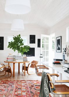 modern home office with white shiplap walls, moroccan area rug, and books as decor. / sfgirlbybay