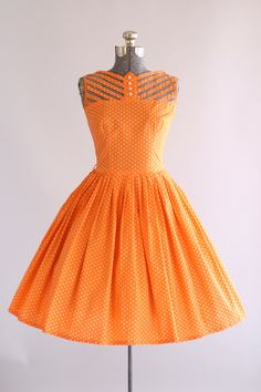 RESERVED RESERVED RESERVED  This 1950s Teena Paige cotton dress features a tiny floral print atop a tangerine orange background. It has this