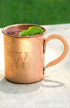 Serving the perfect Moscow Mule in these personalized copper mugs.