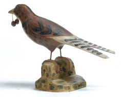 "Garth's Sale 1139 11/27/15. Lot 66 (back). Estimate $1,500-2,500. Sold for $1,875. AMERICAN FOLK ART BIRD. Late 19th-early 20th century. Attributed to Bernier, a lumberjack from Saco-Biddeford, Maine. Swallow tailed bird with original paint. 6.5""h."