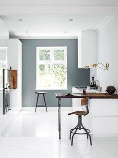 Love the wall color! Cool mix of white and rustic on this kitchen. #kitchen #white