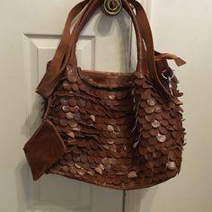 Ameri leather bag Brown Ameri leather bag. Never used. Inside has middle zippered divider pocket. Detachable shoulder strap. Ameri Leather Bags Shoulder Bags