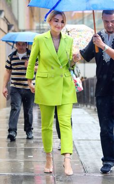 Rita Ora from The Big Picture: Today's Hot Photos  Suit up! The songstress braves the rain in a lime-green suit in New York City.