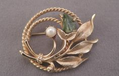 "Signed Sarah Coventry ""Jade Garden"" Gold Tone Circle Pin with Cultured Pearl and Jade Pebble 1966 by thejeweledbear on Etsy"