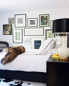 Home Tour: A Sleek New Life For a Greenwich Ranch. the gallery wall in bedroom