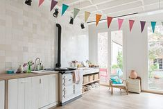 cream tiles of various shades on the wall - An inside look into a Scandinavian house in the center of Ghent 4 Oh My Home, Ideal Home, Bright Kitchens, Home Kitchens, Cuisinières Vintage, Kitchen Living, Kitchen Decor, Living Room, Modern Scandinavian Interior