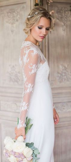 The perfect dress for a later in life bride. Just love the lacy sleeves!