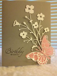 handmade birthday card ... rich mocha card with ivory die cut florals ...peach die cut butterfly layered with matching stained glass style wing lines ... lovely card ...