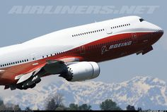 Gear up - rare sunny day in Seattle for 747-8JK Intercontinental departure from Boeing Field