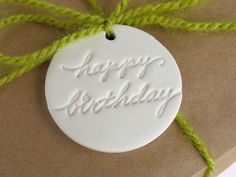 clay gift tags HAPPY BIRTHDAY- set of six classic white stamped gift tags/ ornament/ friend/ birthday packaging. $10.50, via Etsy.