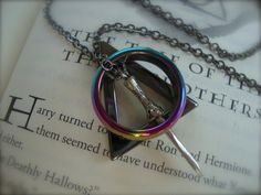 DEATHLY HALLOWS III - Unisex Harry Potter Inspired Deathly Hallows Necklace With Iridescent Hematite Ring Gunmetal Three Peverell Brothers. $32.00, via Etsy.