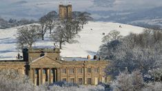 The house and The Cage in snow at Lyme, Cheshire