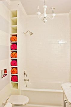 Even the smallest nooks and crannies can be put to good use as this reader did by creating a ceiling-height towel rack between wall and tub. | thisoldhouse.com