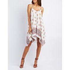 Charlotte Russe Printed Handkerchief Hem Dress ($33) ❤ liked on Polyvore featuring dresses, ivory, shift dress, floral dress, embellished dress, v-neck dresses and winter white dress
