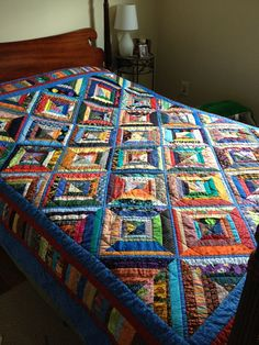 love the colors on this string quilt!    I'd LOVE to make this for our bed-even the hand quilting!  I'm insane....