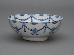 18th Century English Delft punch bowl. Punch was a very popular drink in early 18th century Great Britain, prior to the popularity of wine. It was introduced in the mid 17th century, and consisted of five ingredients : water, sugar, limes, lemons or oranges, spices and spirits. It could be served warmed or chilled.