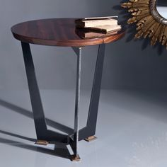 Tryptic, side table. Natural glossy rosewood top, rough steel and brass detail on base.  Designed by:  Ardeco Studio~Georges Amatoury. To be ordered online through www.levantania.com