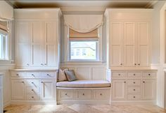 built-in custom closet system with a window seat