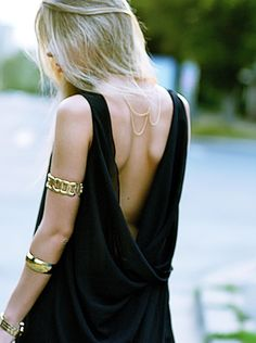 Arm cuffs and backless top. notice the delicate necklace worn in back- so chic
