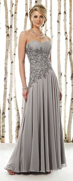 Strapless sweetheart chiffon A-line dress with ruched empire bust line, intricately hand-beaded and embroidered midriff with asymmetrically dropped waistline, full bias-cut gathered skirt. Matching shawl and removable straps included. GORGEOUS!!