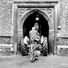 This picture shows a tractor being driven through the century doorway of a church in Hatfield, Herfordshire during preparations for a fesival in 1960 a church in Hatfield, Herfordshire during preparations for a harvest festival in Photo John Gay Fine Art Prints, Framed Prints, Canvas Prints, Poster Size Prints, 1000 Piece Jigsaw Puzzles, Saints, England, Artwork, Hatfield Hertfordshire