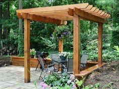 fabriquer une pergola autoportée en bois pour la terrasse de jardin en dalles
