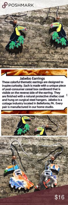 Jabebo Toucan Earrings Very light weight toucan earrings made from recycled cereal boxes with non-toxic shellac coating. Water resistant but not water proof. All original artwork researched for accuracy. Adorable! Jabebo Jewelry Earrings