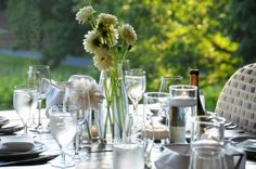 Green table decor and glass centerpiece