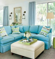 Beach bliss home with bright blue sofa seating in the living room: http://www.completely-coastal.com/2016/04/coastal-house-tours-wayfair-shop-the-look.html