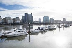 Boats in the Thames by Chelsea Harbour.  If you need any help around your property Melchior Gray is a London-based property maintenance company. We specialise in responsive maintenance, painting/decorating & small building projects. Call our team today on 020 7731 2100 www.mglondon.uk