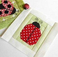 Block 96 - Paper-pieced Ladybug.  A free block from Handiwerx.  Polka dots have never looked so cute.