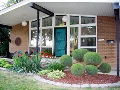 Midcentury house. Love the door!