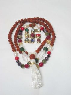 """Tarini Jewels"" Meditation Mala Five Mukhi Rudraksha Navratna Beads Japa Mala of 108 + 1 with Swastik Pendant Mogul Interior,http://www.amazon.com/dp/B00EOKT8UK/ref=cm_sw_r_pi_dp_hytisb07YTMM41XE"