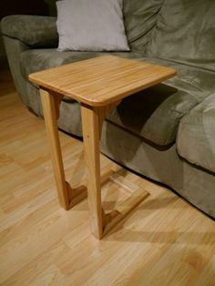 Jason Beaulieu's sofa table. I like the construction of this one, especially the open front on the base.