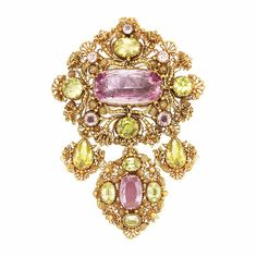 Antique Gold, Foiled-Back Pink Topaz and Yellow Chrysoberyl Cannetille Brooch  The fancy-shaped brooch of cannetille floret and scroll decoration supporting three flexibly-set pendants, embellished by 2 oval foiled-back pink topaz approximately 10.4 x 21.0 mm. and 11.0 x 7.6 mm., accented by 10 vari-shaped yellow chrysoberyl and 4 small round pink topaz, circa 1830, approximately 20.3 dwts.