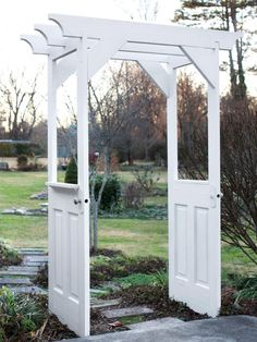 This small white arbor was constructed from repurposed doors.