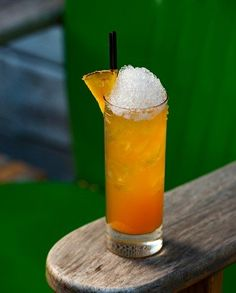 What The Dickens?: White Rum, Cognac, Simple Syrup, Lime Juice, Pineapple Juice, Peychaud's Bitters, Angostura Bitters, Pineapple Wedge.