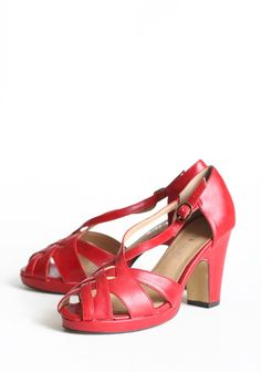 """Astoria Strappy Heels By Chelsea Crew 64.99 at shopruche.com. These red faux leather heels are perfected with a chic design, a peep toe detail, and an adjustable ankle strap.  Slightly padded footbed, 3.5"""" heel"""