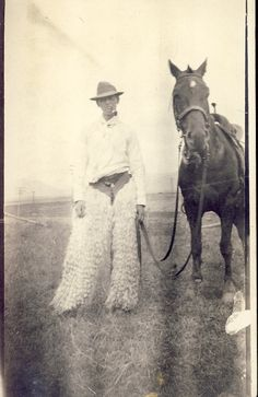 Clyde Is a Real COWBOY with WOOLY CHAPS and Smoking a Pipe with His Horse. Country Western Photo Postcard circa 1910