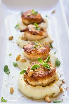 Seared scallops over parsnip puree. Seared scallops over parsnip puree - buttery scallops served atop a luscious sweet parsnip puree spiced with nutmeg & toasted pine nuts. Fish Recipes, Seafood Recipes, Gourmet Recipes, Cooking Recipes, Healthy Recipes, Gourmet Desserts, Appetizer Recipes, Plated Desserts, Gourmet Foods