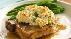 Serve these mouth-watering pork chops and gravy with STUFFING BISCUITS made using Original Bisquick® mix – a delicious dinner.
